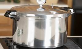 a pressure canner sits on a stove