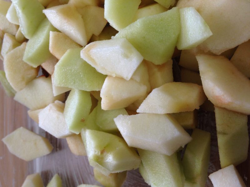 closeup shot of peeled and chopped apples.