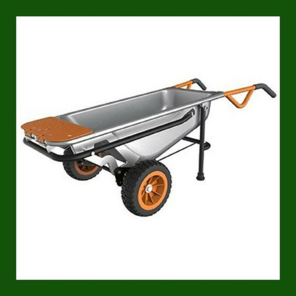 A heavy duty garden carts sits in the yard