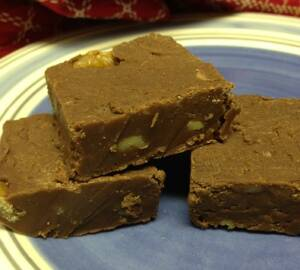 chocolate fudge sliced onto a blue plate