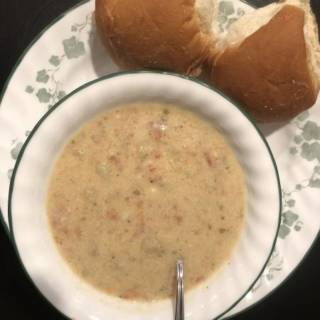 a warm bowl of smoked salmon chowder with two buns