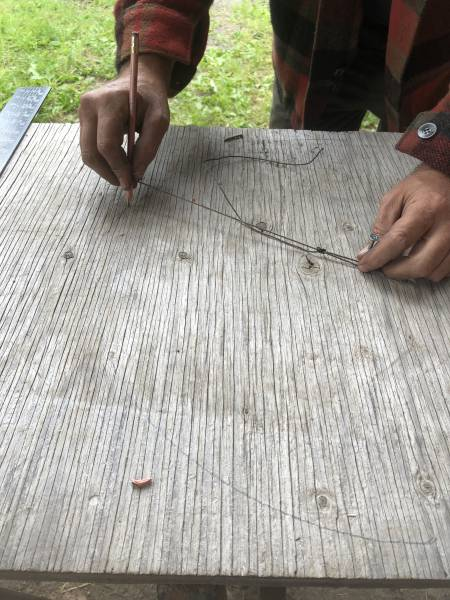 you can use a string and pencil to make a perfect circle for the base of the star