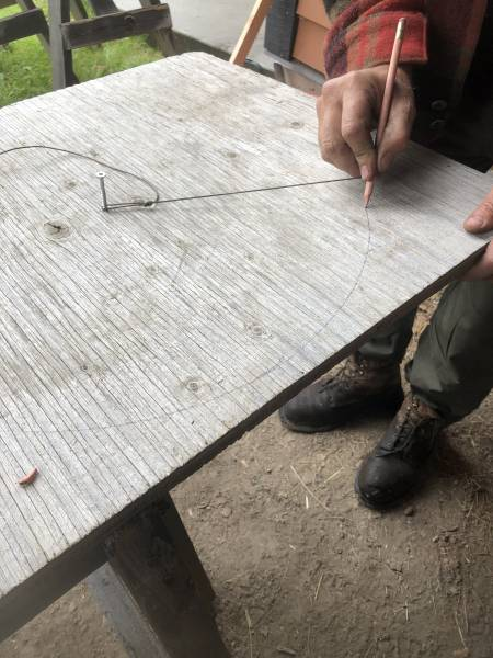 using a home made string compass to make a perfect circle shape
