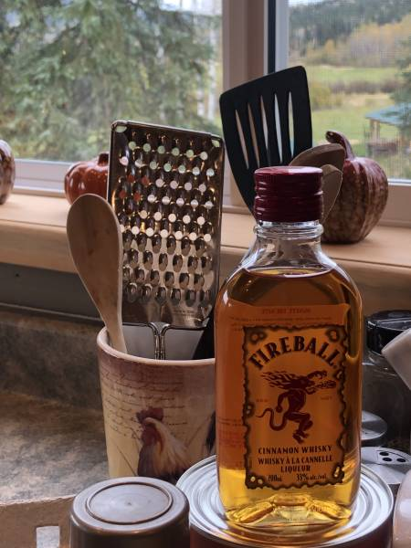 a bottle of Fireball Cinnamon Whiskey on kitchen counter