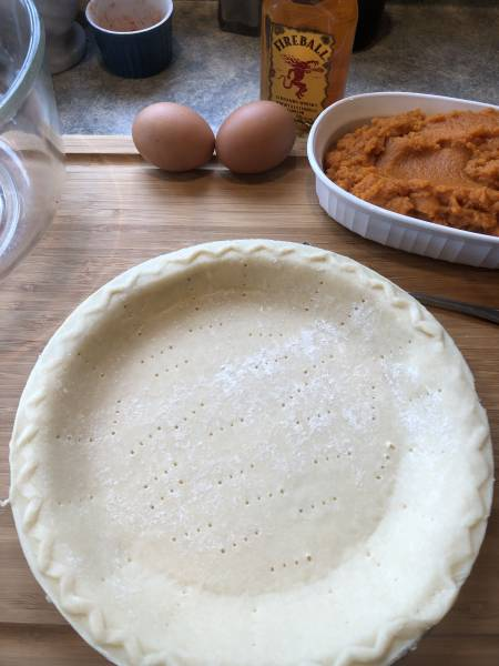 Holes poked into a pie crust before baking in oven.