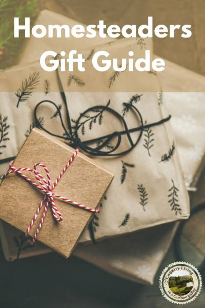 Holiday gifts wrapped in brown paper and tied with cotton ribbon