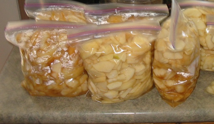 Bags of prepared pie filling waiting to be put into freezer