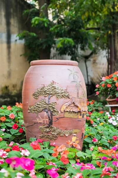 A decorated large pot in the garden.