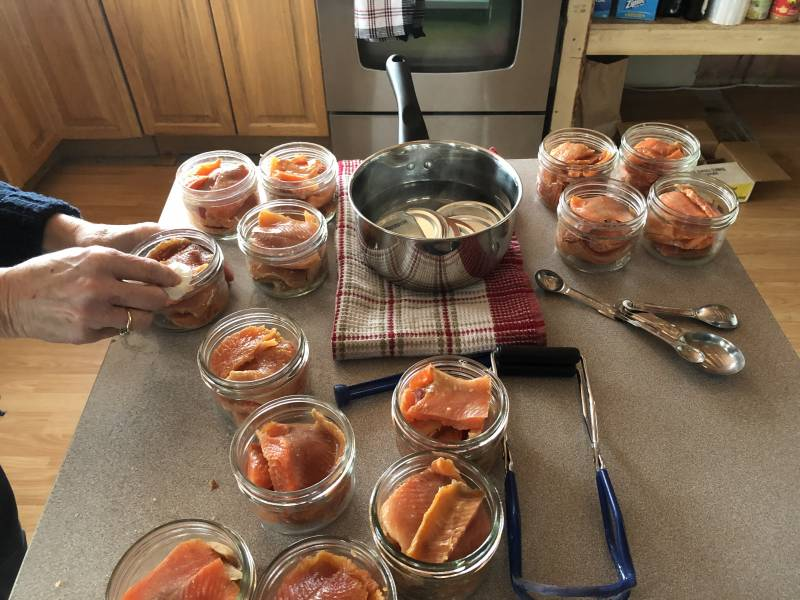 getting mason jars of salmon ready to go in pressure canner