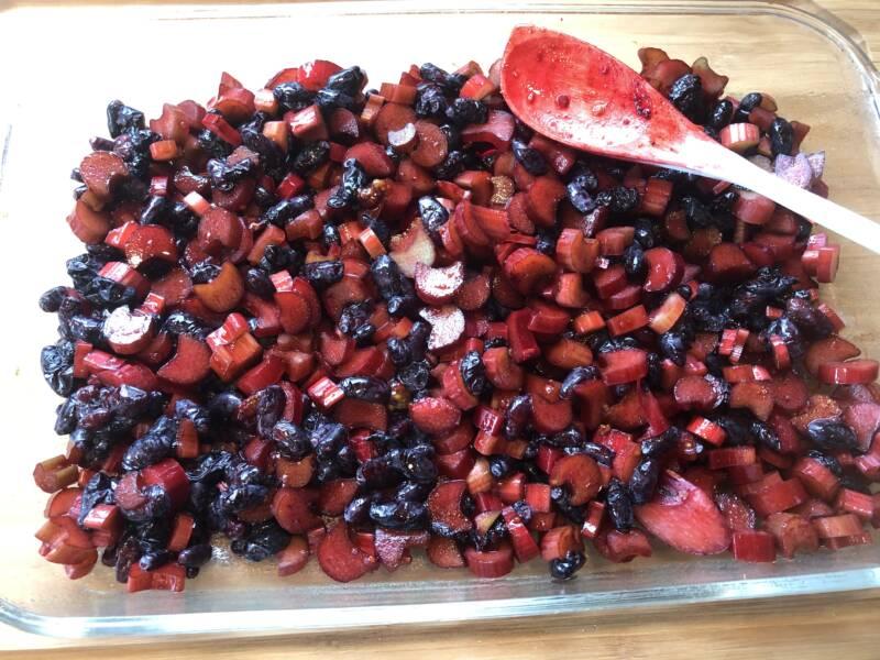 diced rhubarb mixed with Haskap berries for a fruit crisp.