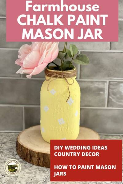 Chalk painted daisy mason jar on farmhouse counter.