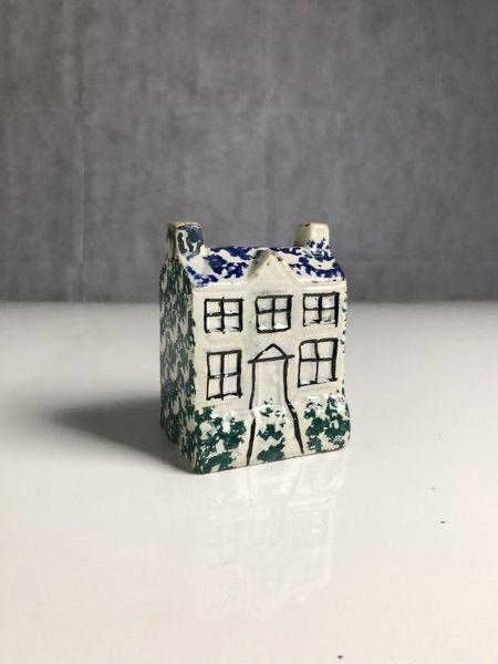 Small pottery money box in the form of a cottage Front