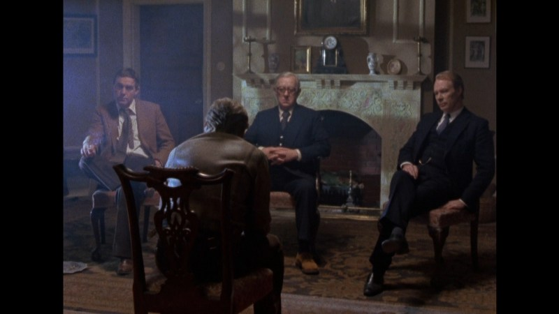 From Tinker Tailor Soldier Spy: Smiley, Guilliam, and Lacon question Ricki Tarr.