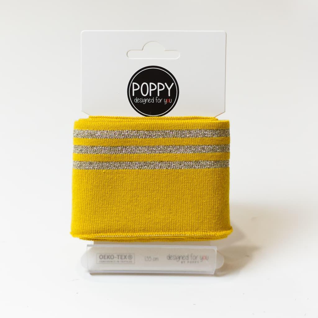 poppy tissu jersey bord cotes a rayures lurex dore sur le fond ocre carte de 135 cm
