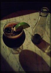 Boozy Cola: Rum, Fernet, Sassafras, served with a cola bottle.