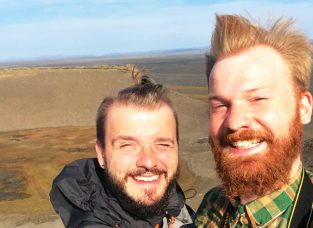 Icelandic storm and our faces | Gay Couple Road Trip East Iceland © Coupleofmen.com