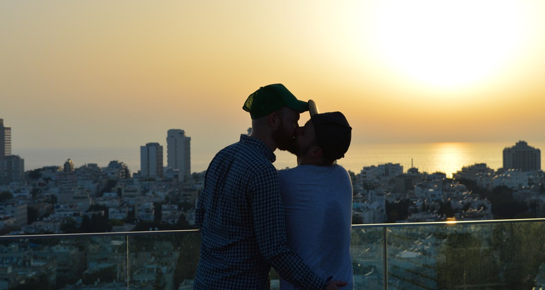 Gay Couple gay men kiss sun set beach Gay Pride Week Tel Aviv Israel 2016