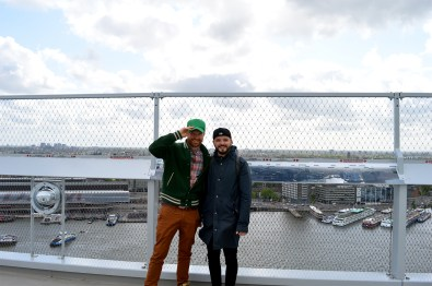 Hand-in-hand overlooking Amsterdam | The Best Amsterdam view A'DAM LOOKOUT © CoupleofMen.com