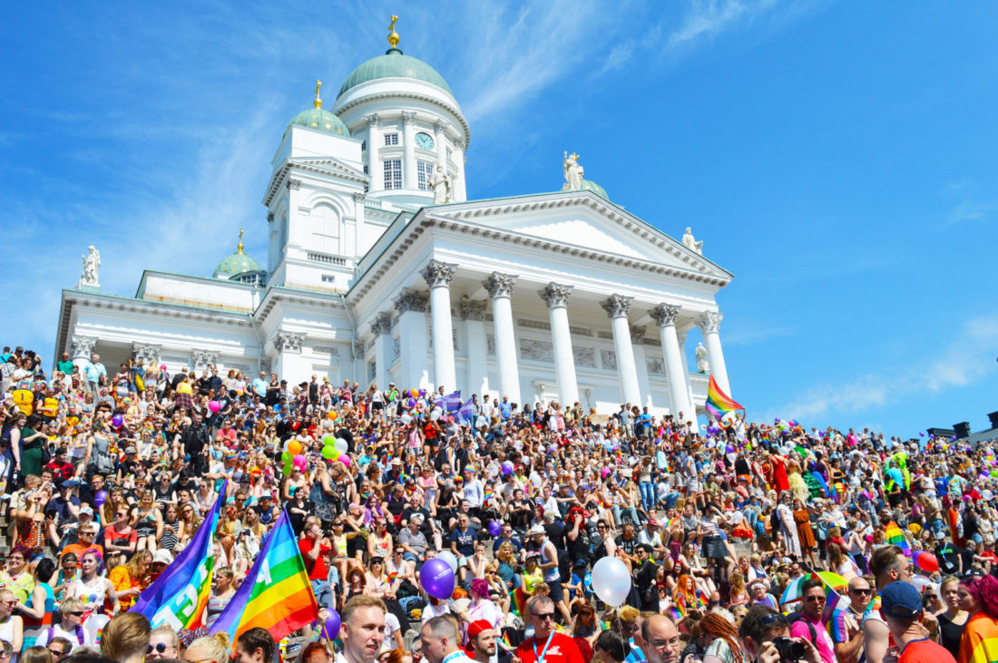 Gathering of the rainbow colored crowd for Gay Pride Helsinki LGBTQ Festival Parade © CoupleofMen.com