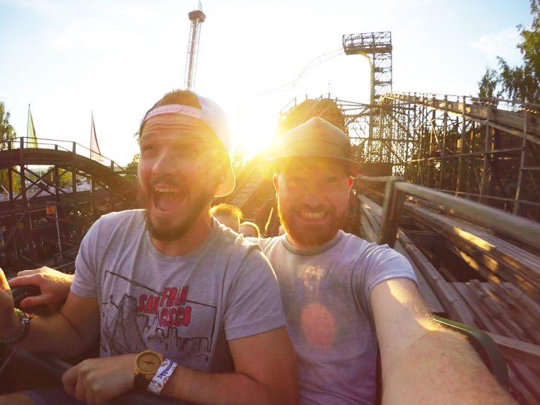 "Gay Travel blogger Karl & Daan riding wooden roller coaster ""Vuoristorata""   Our Gay Couple Review Theme Park Linnanmäki Helsinki Finland © Coupleofmen.com"