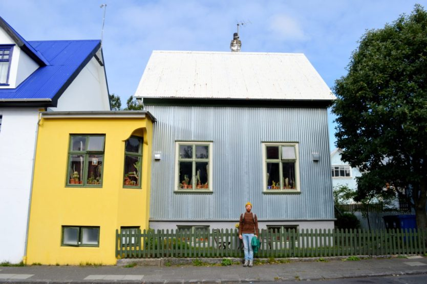 Daan in front of a grey and yellow house | Gay Couple Travel City Weekend Reykjavik Iceland © Coupleofmen.com