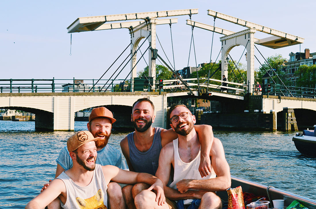Karl and Daan on a boat trip together with Kit Williamson and John Halbach | Rent Canal Boat Amsterdam Boats4rent © CoupleofMen.com