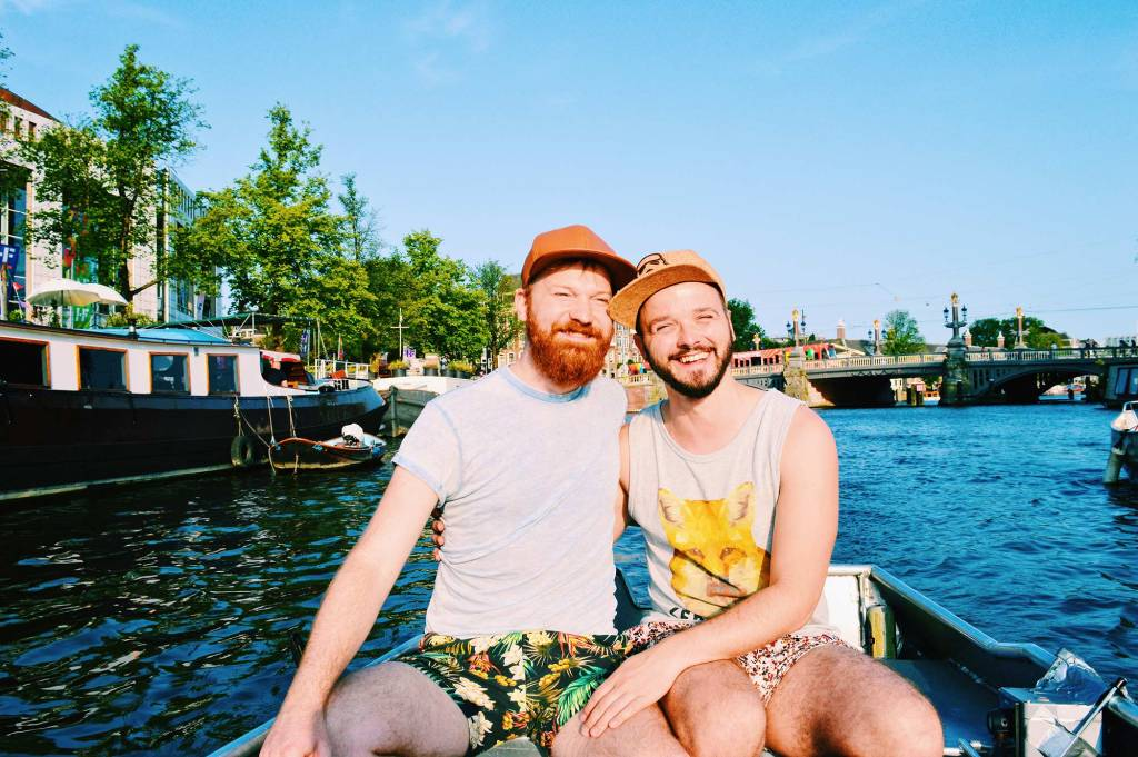 Karl & Daan driving their own rental boat in Amsterdam | Gay Couple Rental Canal Boat Tour Amsterdam Boats4rent © CoupleofMen.com
