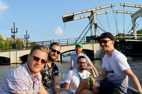 Amsterdam Canal Boat Captain | Gay Couple City Weekend Amsterdam © CoupleofMen.com