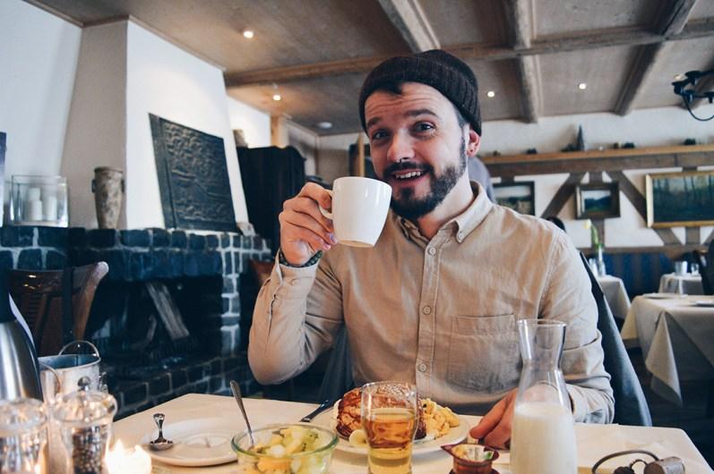 Karl enjoying his fresh coffee at Taufsteinhütte | Slumber Wine Barrel Taufsteinhütte © Coupleofmen.com