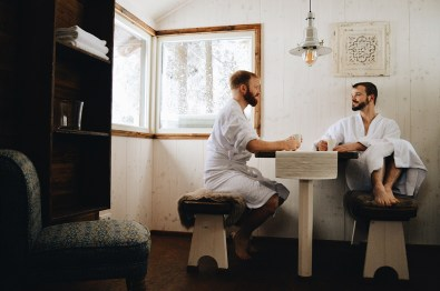 two gay men dirnking tea coffee at sauna Slumber Wine Barrel Taufsteinhütte Central Germany © CoupleofMen.com