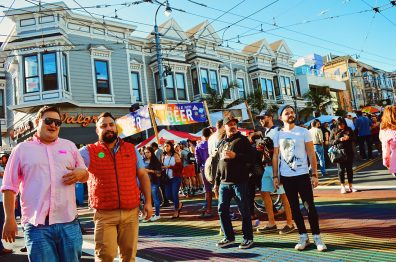 Photos Castro Street Fair Karl standing on the permanent rainbow crosswalk | Our Photo Story Castro Street Fair San Francisco © CoupleofMen.com