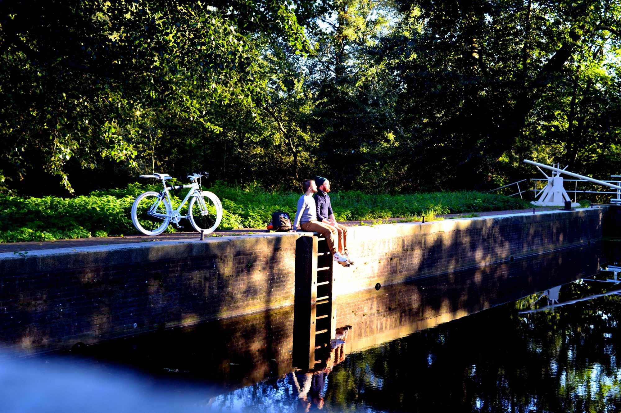 Gay Couple Biking Trips Amsterdam Forest © CoupleofMen.com
