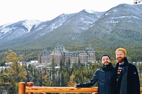 Gay Travel Blogger Couple of Men in front the Fairmont Banff Springs Castle Hotel Gay-Friendly © CoupleofMen.com