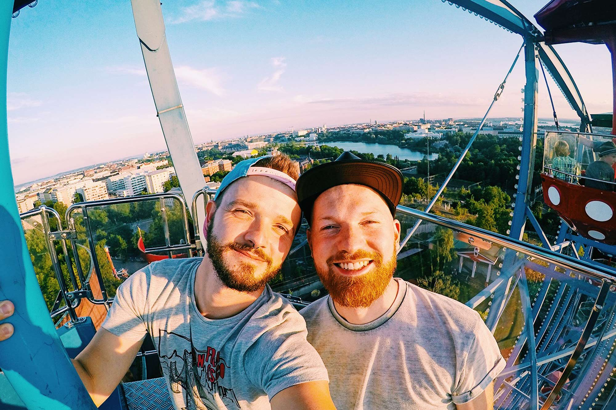 Karl & Daan riding Ferris Wheel | Gay Couple Review Theme Park Linnanmäki Helsinki Finland © CoupleofMen.com