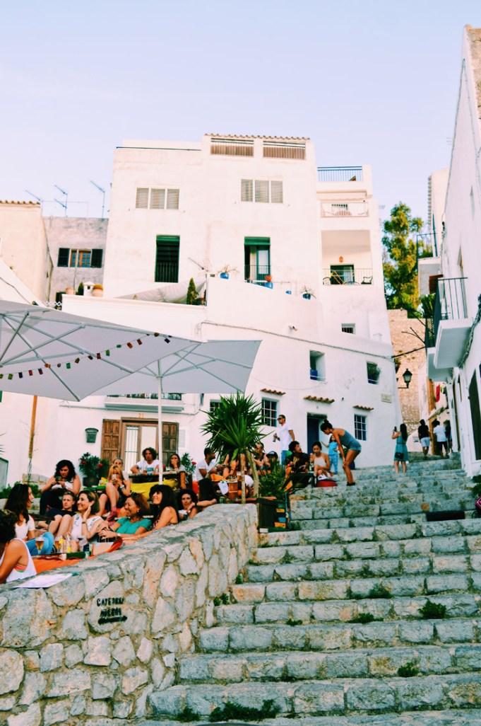 Magical atmosphere on Ibiza Old Town stairways during Ibizan sunset | Gay Couple Travel Gay Beach Ibiza Town Spain © CoupleofMen.com