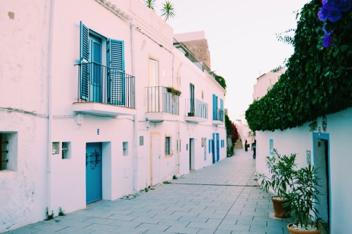 Ibiza Gay Travel Tips Gay Travel Ibiza White old town houses of Ibiza | Gay Couple Travel Gay Beach Ibiza Town Spain © CoupleofMen.com