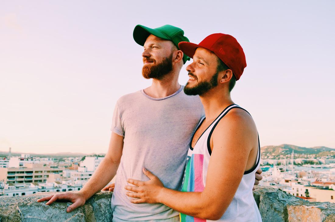 Ibiza Gay Travel Tips Gay Travel Ibiza Gay Couple Karl & Daan enjoying sunset | Gay Couple Travel Gay Beach Ibiza Town Spain © CoupleofMen.com