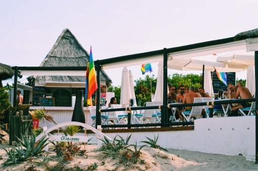 Gay Travel Ibiza Terrace with Rainbow flags at Ibiza Gay Beach | Gay Couple Travel Gay Beach Ibiza Town Spain © CoupleofMen.com