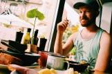 Daan having breakfast at holiday   ROCKET ROOMS Velden Wörthersee gay-friendly © CoupleofMen.com