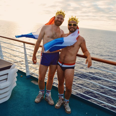 Gay Travel Blogger with Dutch Flags and the sunset   Where are you from Party The Cruise 2017 © CoupleofMen.com