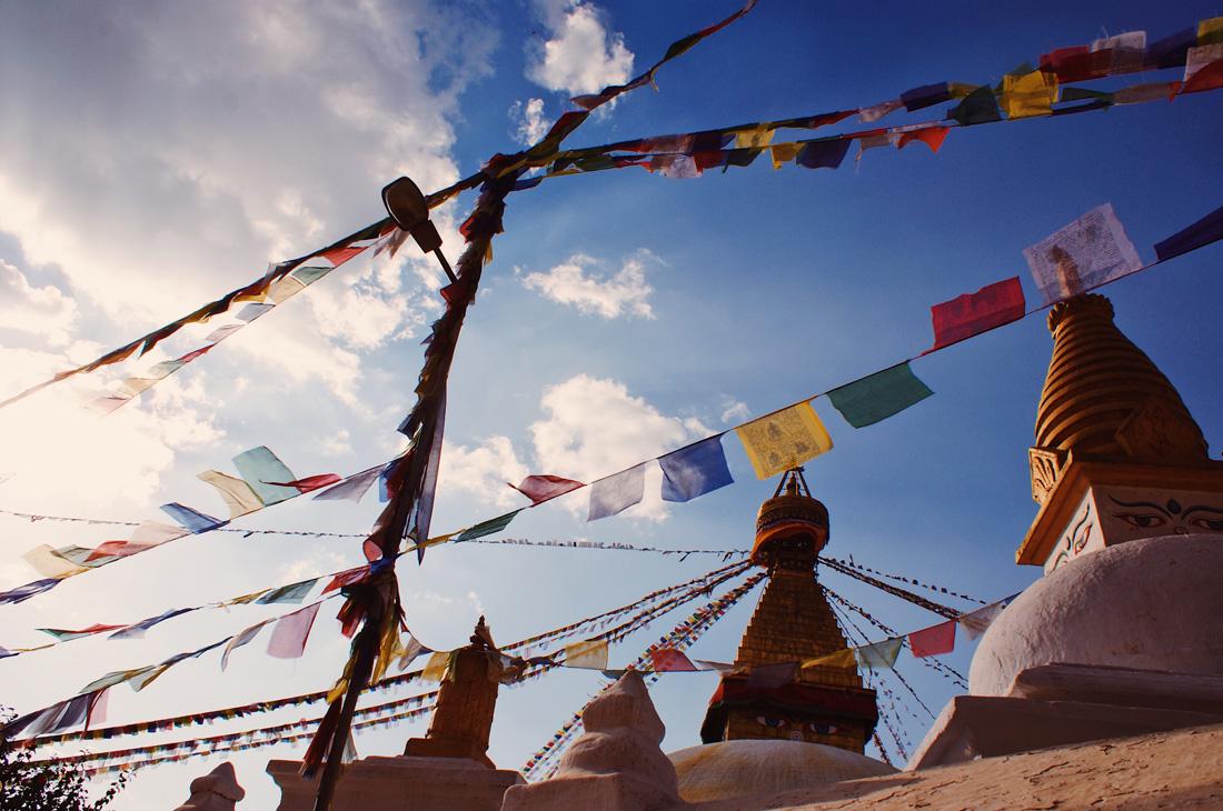 Praying flags waving over the Boudhanath Stupa | Gay Travel Nepal Photo Story Himalayas © Coupleofmen.com
