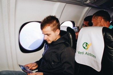 Karl sitting inside the Yeti Airlines plane going on an Everest Sight-Seeing Tour | Gay Travel Nepal Photo Story Himalayas © Coupleofmen.com