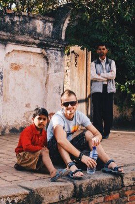 Karl and his new friend sitting in the backyard of the Royal Palace of Bhaktapur | Gay Travel Nepal Photo Story Himalayas © Coupleofmen.com