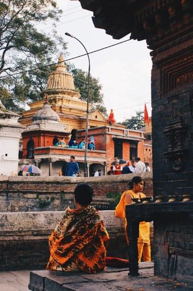 Praying woman at Temple Pashupatinath   Gay Travel Nepal Photo Story Himalayas © Coupleofmen.com