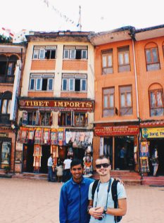 Karl and his guide of the day in front of the surrounding buildings at Boudhanath Stupa | Gay Travel Nepal Photo Story Himalayas © Coupleofmen.com