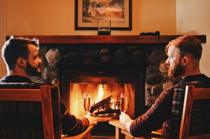 Relaxing in front of the open fireplace in our room | Emerald Lake Lodge gay-friendly accommodation © Coupleofmen.com