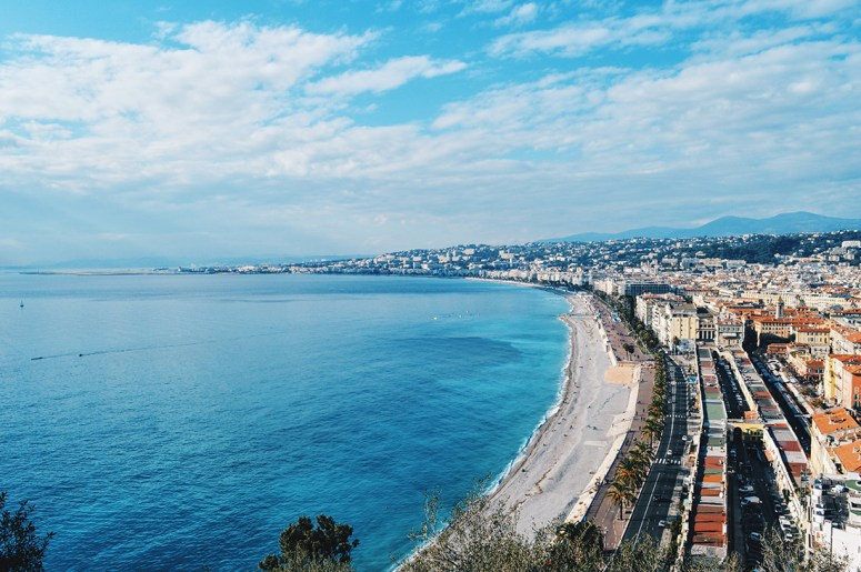 View of the beach and City of Nice from the castle hill Gay Couple City Weekend Nice © CoupleofMen.com