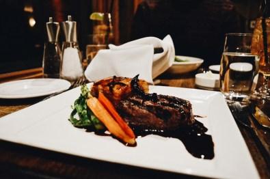 Bison steak at Mount Burgess Dining Room | Emerald Lake Lodge gay-friendly © Coupleofmen.com