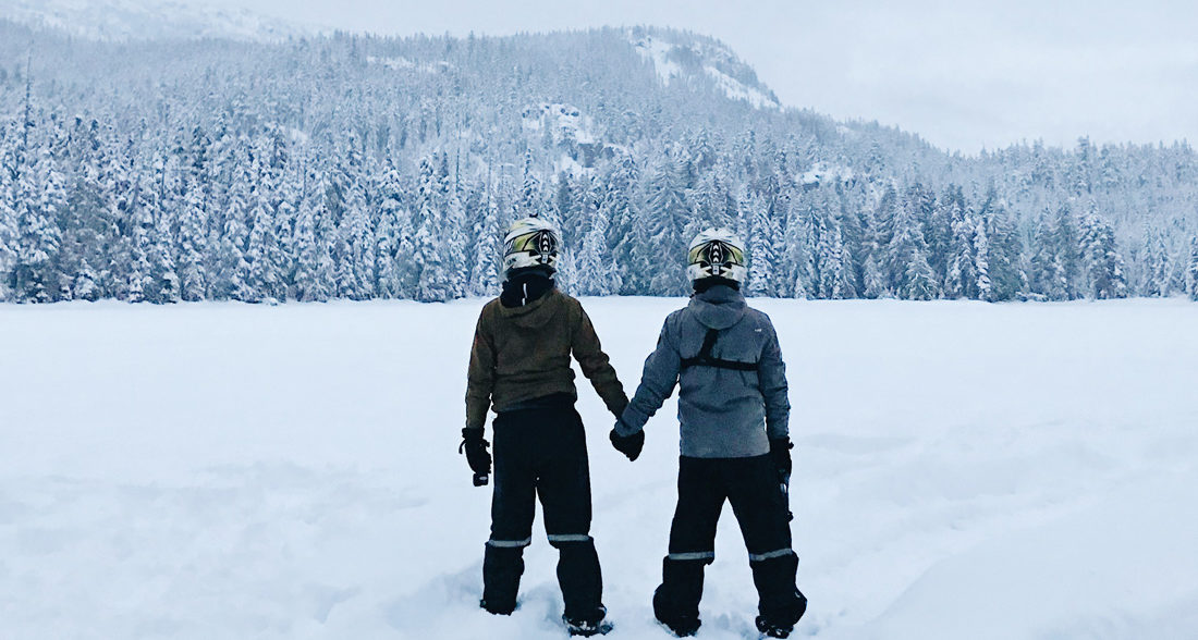 Hand-in-hand in the middle of winter wonderland nowhere | Zip Lining Snowmobiling TAG Whistler Gay-friendly © Coupleofmen.com