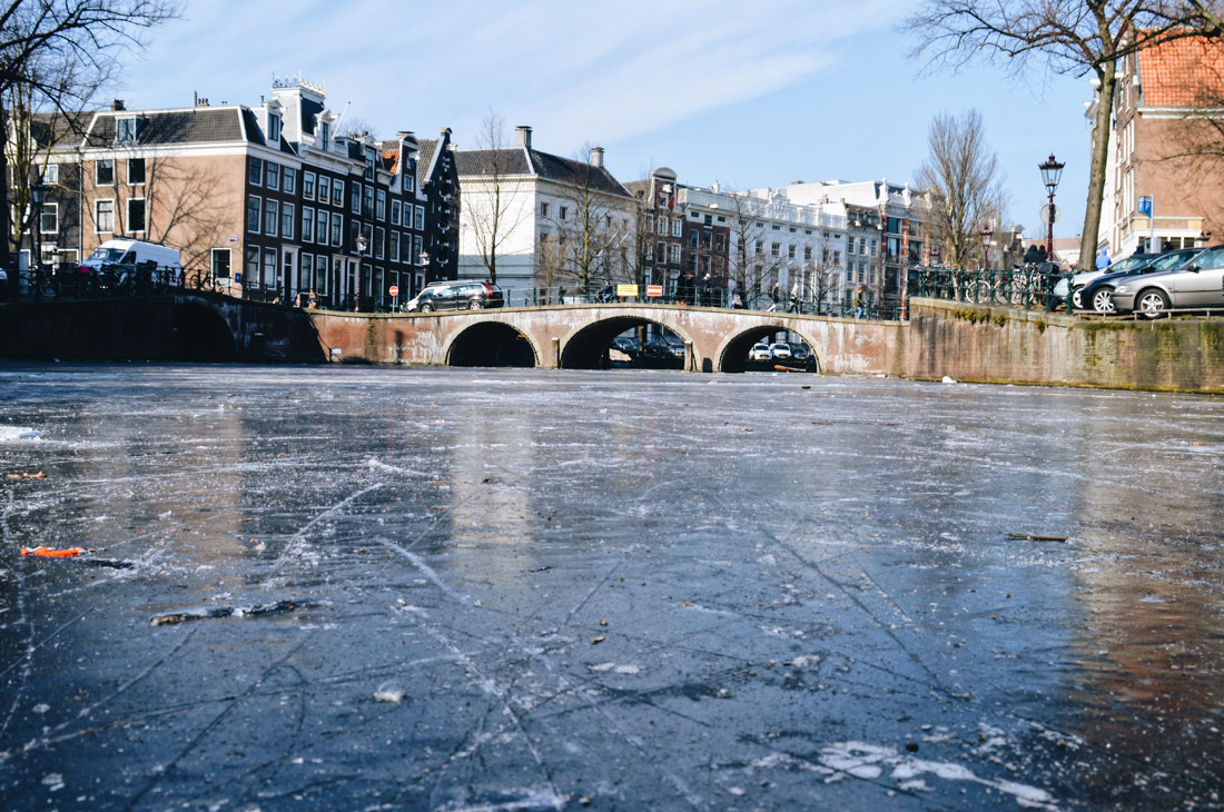 Winter on Amsterdam's Frozen Canals Thick Ice of the Frozen Canals in Amsterdam   Amsterdam Frozen Canals © Coupleofmen.com